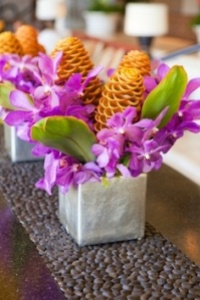 Arrangement of tropical blooms on a contemporary table.