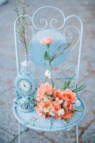 blue chair peach roses